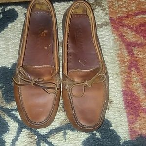 Cole Hann brown leather loafers.